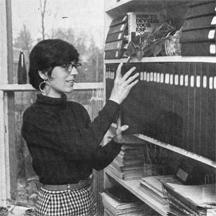 Jane Roberts with shelf of notebooks