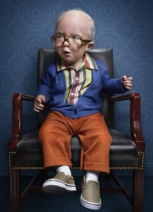 little boy dressed as an old man