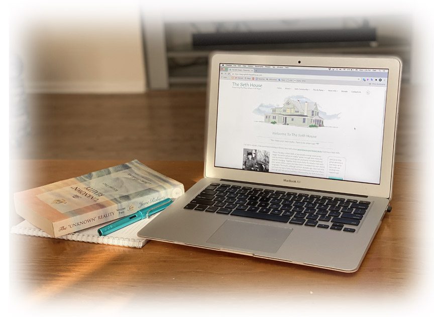open laptop showing seth house website